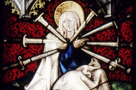 Photo Mater Dolorosa, Stained Glass window dated to 1513. The seven swords represents the seven sorrows of the Virgin Mary.