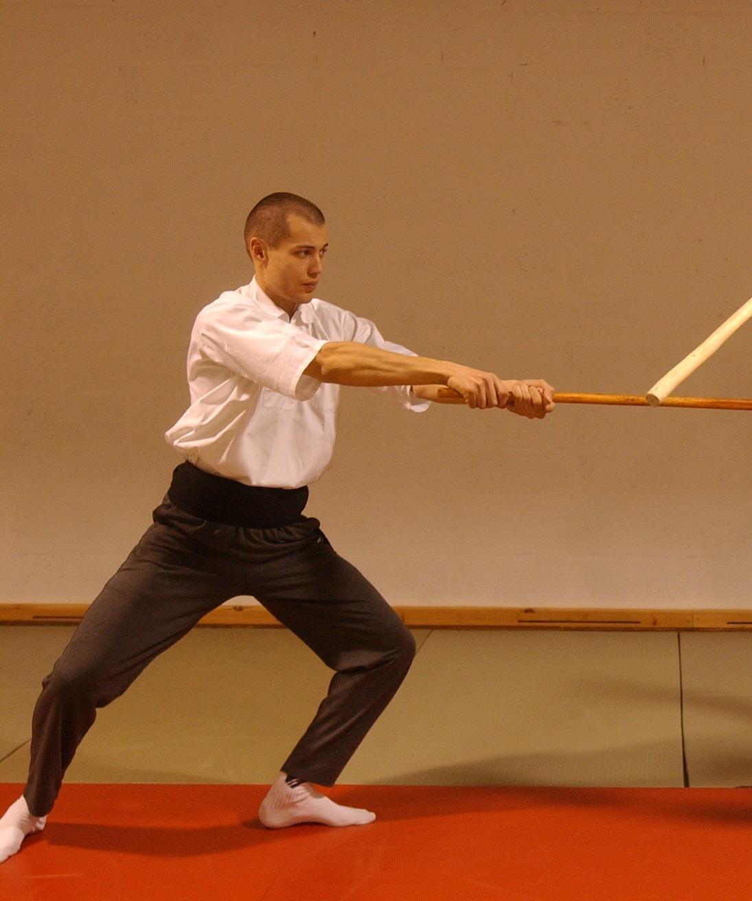 Finishing a strike from left to right and thus being slightly off balanced towards the right side