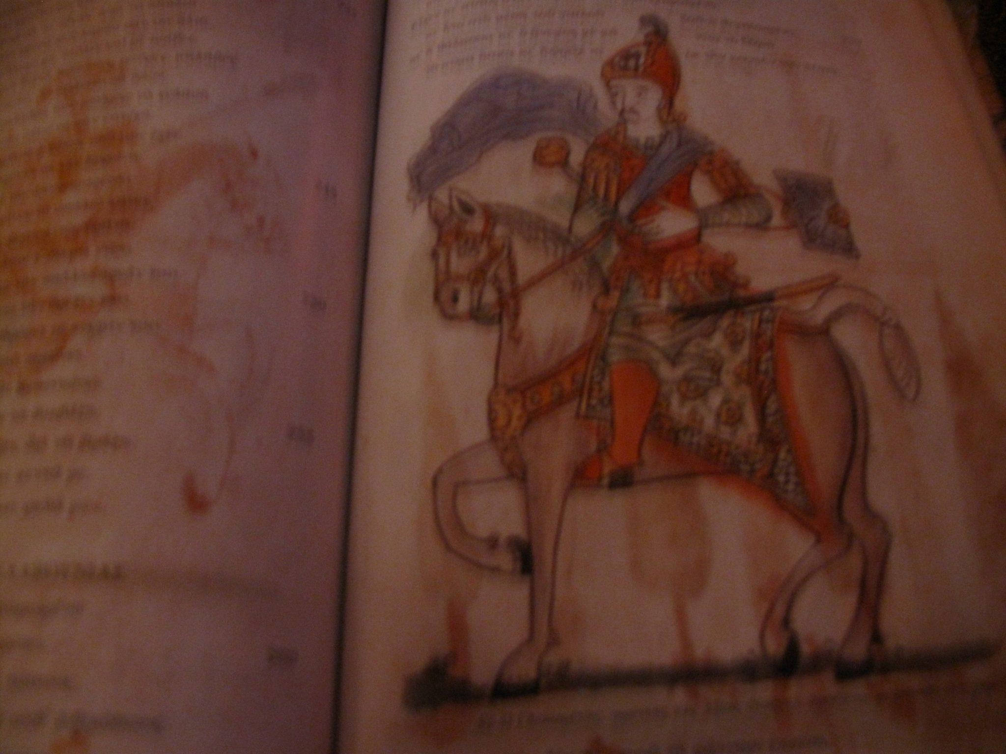 p.57r Glikaretos,lord of Axias (Naxos island) with a mace and a small shield at his hand.