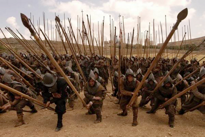 The use of sword behind the shield wall and phalanx