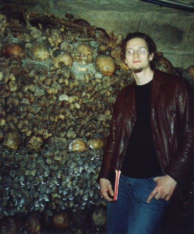 Me in my early 20s in the catacombs of Paris.