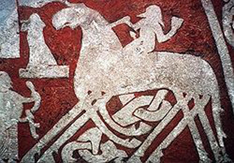 Odin depicted riding his eight-legged horse Sleipnir on the Tjängvide image stone.