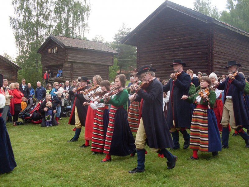 Traditional Swedish Midsummer feast. Young and old uphold tradition, telling a story spanning generations.