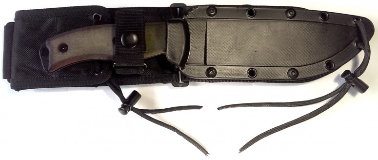 ESEE-6 in the plastic sheath. Pommel folding cover clearly visible