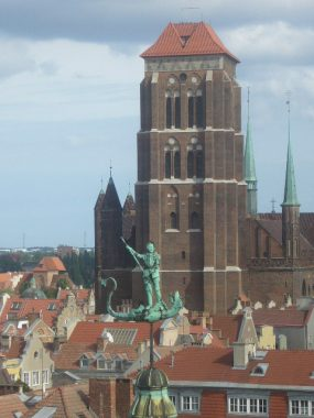 St Mary's Church in Gdansk, from a distance, while a bronze statue of St. George slays the dragon in the foreground. According to the wiki, the Church of St. Mary can hold 25,00 people.
