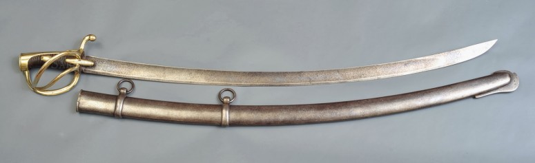 Light cavalry saber (An. XI-pattern, known as the 'chasseur-sabre') and iron scabbard, made at Klingenthal: this was the weapon of the light cavalry, Hussars, Lancers, Chasseurs à Cheval. This saber has a weight of 1,21 kg (the scabbard weights about 1,3 kg) and a blade of 87 cm. Source: http://swordscollection.blogspot.com.ar (retrieved 5-05-2015)